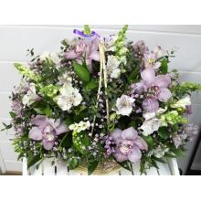 Праздничная корзина из лиловых орхидей, антириниума, белых фрезий, розовой гипсофиллы, альстромерии, эвкалипта, итальянского рускуса, зелени с атласными лентами.