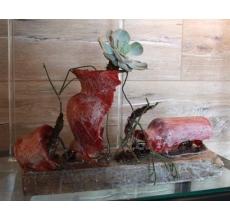 Настольная композиция с каркасами посуды, бумагой ручной работы, парафином. Растения: эхеверия, рипсалисы. Растение будет продолжать счастливо жить и развиваться, если пополнять запасы воды в сосудах.