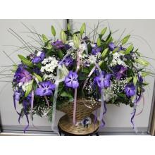 Большая корзина из орхидей ванда, лилий, хризантем, гипсофиллы, зелени, разноцветных лент с брошью на ножке.