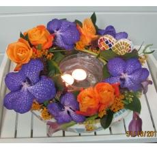 Орхидея ванда с плавающими свечами в керамическом кашпо с мозаикой